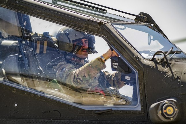 An Army AH-64E Apache helicopter pilot prepares to depart for a mission from Jalalabad Airfield, Afghanistan, on April 25. The Defense Department is expected to recieve authority to determine troop levels in Afghanistan. File Photo by Capt. Brian Harris/U.S. Army