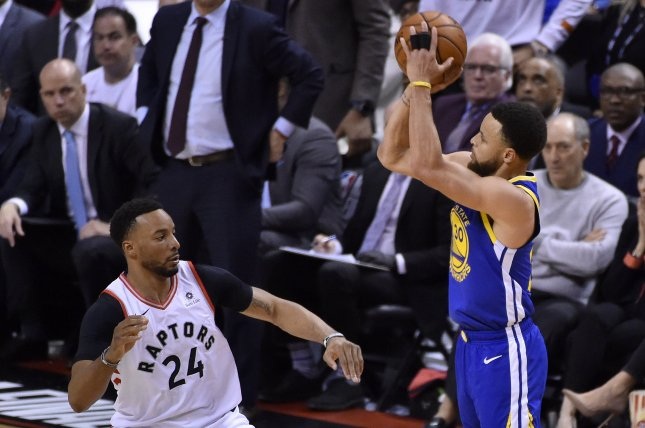 Golden State Warriors guard Stephen Curry (R) shoots over Toronto Raptors defender Norman Powell (L) during the second half in Game 2 of the NBA Finals on Sunday at Scotiabank Arena in Toronto, Canada. Photo by Warren Toda/EPA-EFE