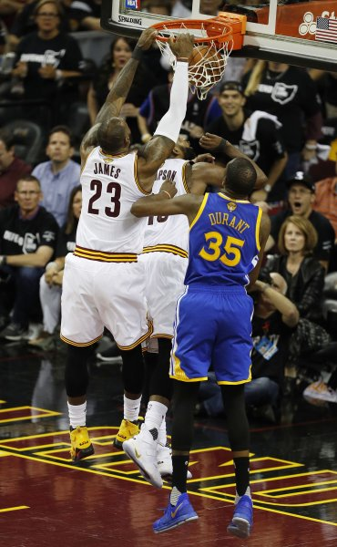 Cleveland Cavaliers forward LeBron James (L) dunks in front of Golden State Warriors forward Kevin Durant (R) in the second half of Game 4 of the NBA Finals Friday at Quicken Loans Arena in Cleveland, Ohio. The series is the highest rated Finals since 1988. Photo by David Maxwell/EPA