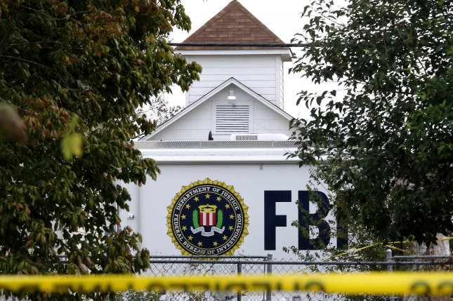 An FBI crime scene truck is parked in front ofthe First Baptist Church in Sutherland Springs, Texas, after a shooting on November 7, 2017. Twenty-seven people died in the attack. File Photo by Larry W. Smith/EPA-EFE