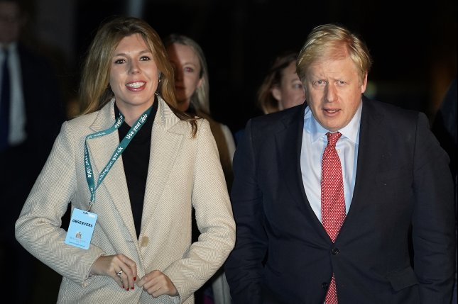 British Prime Minister Boris Johnson and fiancee Carrie Symonds, pictured on December 13, 2019, are now together at the Chequers mansion. File Photo by Will Oliver/EPA-EFE