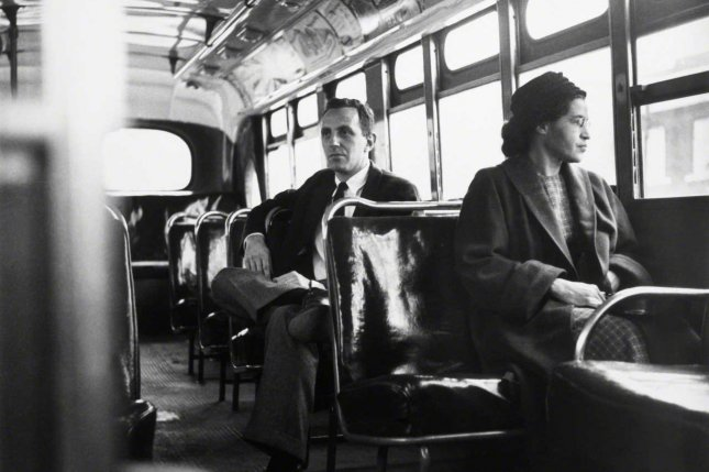 Rosa Parks sits up front of a Montgomery, Ala., bus with UPI reporter Nicholas Chriss in on December 21,1956, one year after she refused to give up her seat to a white man and was arrested. Parks died October 24, 2005. File Photo by UPI