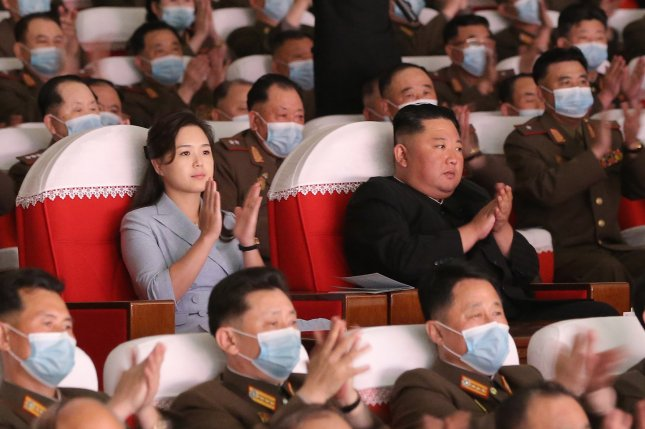 Kim Jong Un (C) and first lady Ri Sol Ju watch a performance of the arts groups of military families in Pyongyang on Wednesday, according to state media. Photo by KCNA/EPA-EFE