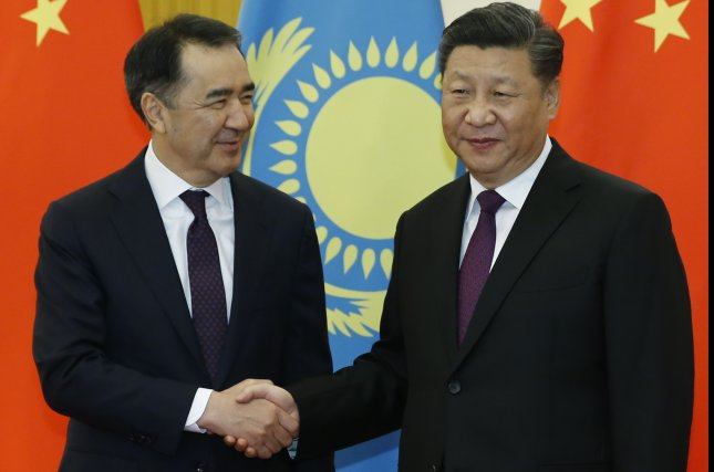 Chinese President Xi Jinping (R) shakes hands with Kazakh Prime Minister Bakytzhan Sagintayev (L) at the Great Hall of the People in Beijing on November 22. Pool Photo by Thomas Peter/EPA-EFE