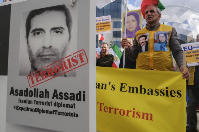 Iranian opposition activists, members of the National council of Resistance of Iran, protest with portrait depicting Iranian official Asadollah Assadi, in Brussels, Belgium in 2018. File Photo by Olivier Hoslet/EPA-EFE
