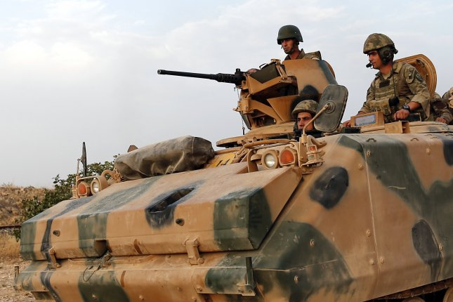 Turkish soldiers return from Syria to Turkey with tanks after a military operation at the Syrian border as part of their offensive against the Islamic State militant group on August 2016. Turkish armed forces and allied Syrian rebels have almost total control of al-Bab, Turkey's defense minister said Tursday. Photo by Sedat Suna/EPA