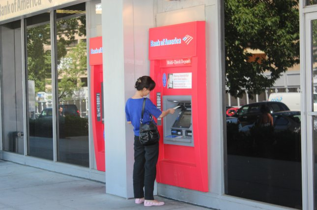 Acoustic wave technology powers many large touch screens, like those found on ATM machines and airport kiosks. Pictured, a woman takes out money at a Bank of America ATM in Washington, DC. Photo by Billie Jean Shaw/UPI