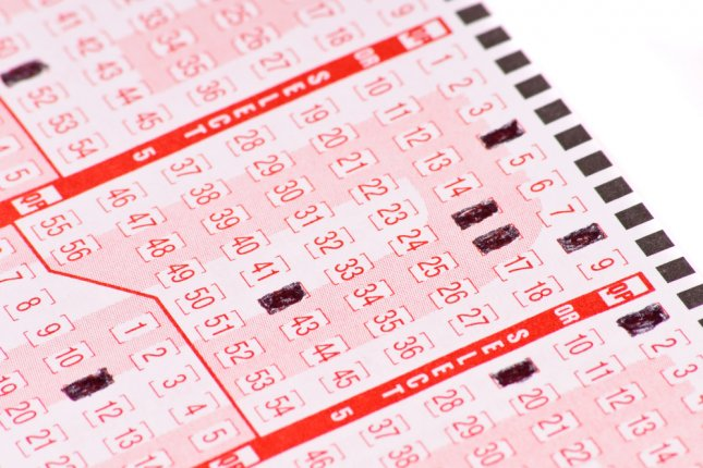 An Australian man who won a lottery jackpot of more than $630,000 said his ticket purchase was inspired by a sign that someone was looking out for me. File photo by jcjgphotography/Shutterstock