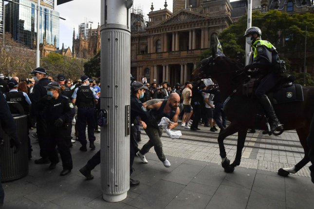 Protesters and police clash Saturday at Sydney Town Hall during an anti-lockdown rally. Photo by Mick Tsikas/EPA-EFE