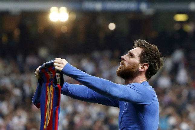 FC Barcelona's Argentinian striker Lionel Messi jubilates the 3-2-victory against Real Madrid during the Liga Primera Division 33rd round match between Real Madrid and FC Barcelona Sunday at the Santiago Bernabeu stadium in Madrid. Photo by Juan Carlos Hidalgo/EPA