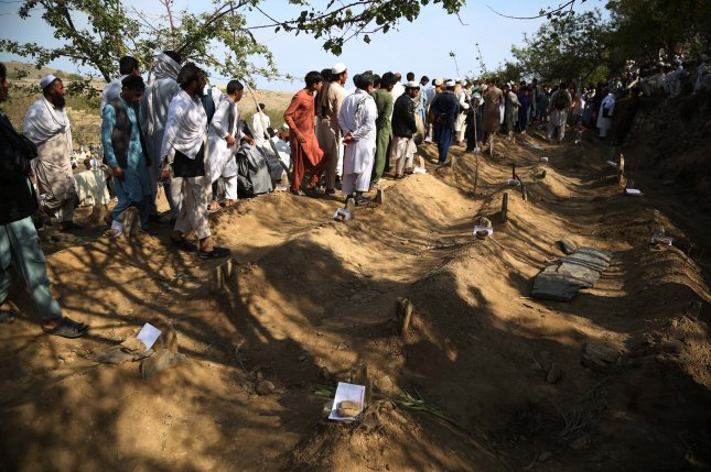 People attend the burial of the victims Saturday, a day after an explosion at a mosque in Haska Mena district of Nangarhar province, Afghanistan. Photo by Ghulamullah Habibi/EPA-EFE