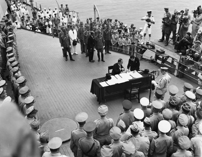 Foreign Minister Mamoru Shigemitsu and Gen. Yoshijiro Umezu of Japan sign the complete capitulation of Japan on September 2, 1945 aboard the USS Missouri in Tokyo. Photo by Ed Hoffman/UPI