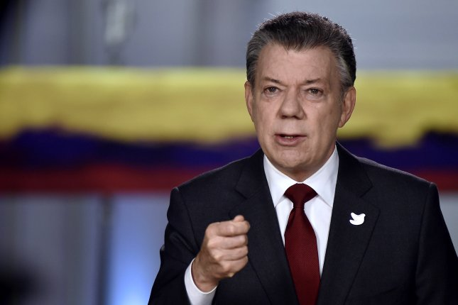 Colombian President Juan Manuel Santos on Tuesday said pressure from the country's armed forces led to the release of eight hostages believed to have been taken by the ELN rebel group. File Photo by Cesar Carrion/EPA