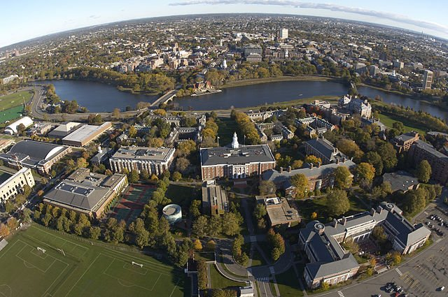 An aerial view of Harvard Business School is shown. Photo by HBS1908/Wikimedia Commons