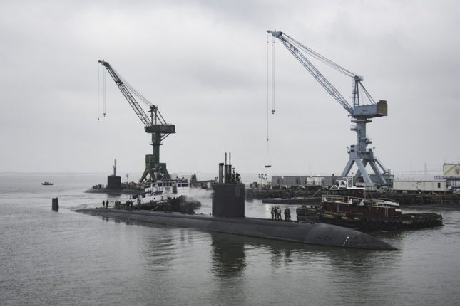 USS Boise arrives at Huntington Ingalls Industries' Newport News Shipbuilding division to begin its 25-month extended engineering overhaul. Photo by Ashley Cowan/Huntington Ingalls Industries