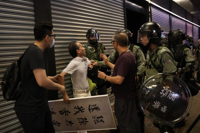 A man is detained by police during a rally against police brutality in Hong Kong, China, over the weekend. The protests have taken a toll on the economy, a third-quarter report released Thursday showed. Photo by Lynn Bo Bo/ EPA-EFE