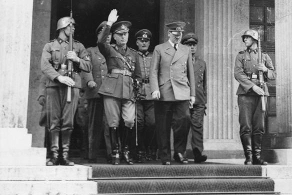 Romanian head of state, Gen. Ian Antonescu (2nd-L) meets with Nazi leader Adolf Hitler (2nd-R) on June 10, 1941. On November 23, 1940, Romania signed the Tripartite Pact, joining the Axis powers of Germany, Italy and Japan in World War II. File Photo courtesy the Germany Federal Archive