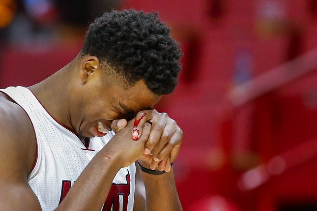 Miami Heat center Hassan Whiteside reacts after injuring his finger during the second half against the Phoenix Suns Tuesday, March 21, 2017 at AmericanAirlines Arena in Miami, Florida. File photo by ERIK S. LESSER/EPA