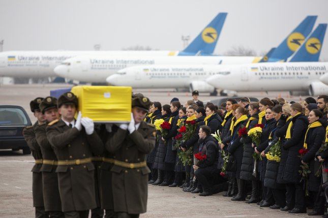 Relatives, friends and officials meet coffins of crew members and victims of the Ukraine International Airlines Flight PS752 at Boryspil International Airport in Kyiv, Ukraine, Jan. 19, 2020. An air traffic recording leaked Sunday suggested Iran knew immediately it shot down a civilian airliner. Photo by Presidential Press Service of Ukraine/EPA-EFE