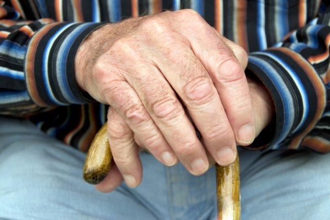 A man with a cane. Photo by linerpics/Shutterstock