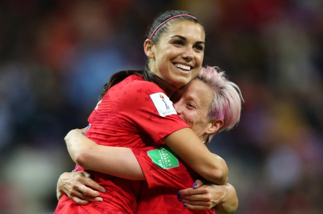 Alex Morgan (L) scored five times and Morgan Rapinoe (R) scored once during the United States Women's National Team's group stage win over Thailand at the 2019 FIFA Women's World Cup on Tuesday in Reims, France. Photo by Tolga Bozoglu/EPA-EFE
