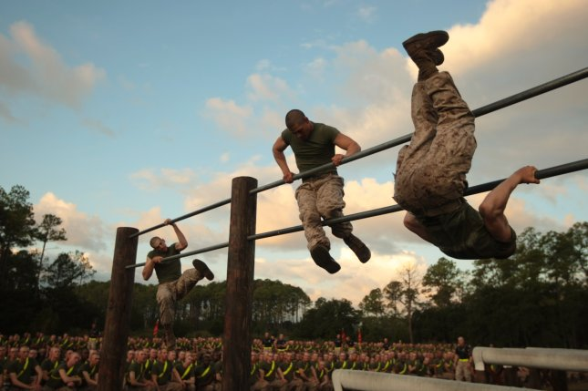Recruits of Mike Company, 3rd Recruit Training Battalion, race through an obstacle course in 2013 on Parris Island, S.C., where one recruit, Raheel Siddiqui, died Friday. Military officials said they are investigating the circumstances of Siddiqui's death. File Photo by Cpl. Caitlin Brink/U.S. Marines