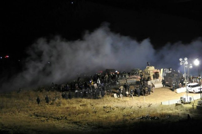 Police and protesters clash on the Backwater Bridge, north of a protest camp in North Dakota's Morton County on November 20, 2016. Police said five individuals were arrested at the bridge this week, the first time police deployed a SWAT team to the area in several weeks. Photo courtesy of Morton County Sheriff's Department