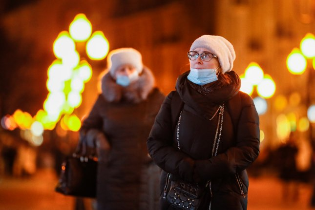 Russian women wear protective face masks while walking on a street in Moscow on Saturday. Photo by Yuri Kochetlkov/EPA-EFE