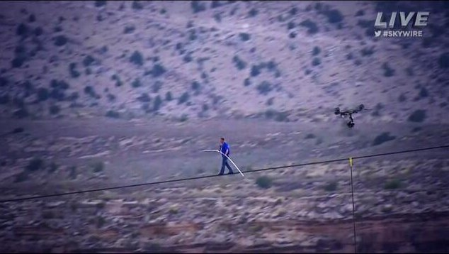 Nik Wallenda competes a stunt walking across a gorge near the Grand Canyon. (Credit: Discovery Channel/Don Lemon on Twitter)