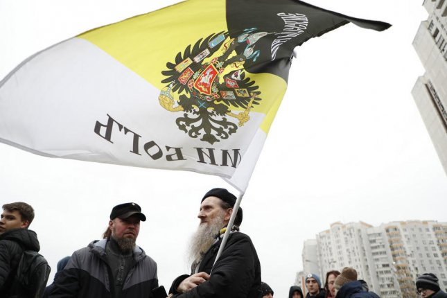 Russian nationalists take part in a Russian March in Moscow's Lublino suburb Monday.Photo by Maxim Shipenkov/EPA-EFE
