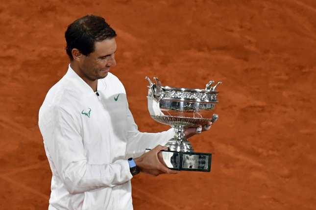Rafael Nadal of Spain (pictured) holds his trophy after beating Novak Djokovic of Serbia in the men's French Open final on Sunday at Roland Garros in Paris. Photo by Julien De Rosa/EPA-EFE