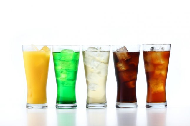 A new study has linked sugar-sweetened beverage consumption with increased bowel cancer risk, with each additional daily serving increasing risk by 16%. File Photo by taa22/Shutterstock