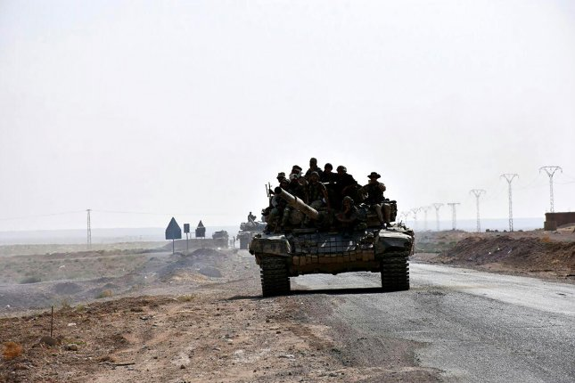 Syrian army units advance in Deir Az Zor, Syria. U.S.-backed airstrikes in the province early Tuesday targeted Islamic State militants in an attempt to drive them from one of their last remaining enclaves. File Photo by SANA/EPA-EFE