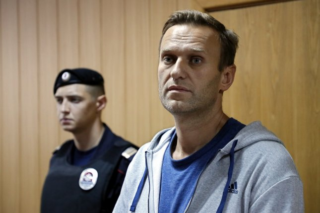 Russian opposition leader Alexei Navalny (R) appears during a judicial sitting in Tverskoy court in Moscow on August 27, 2018. A Russian court ordered him detained for 30 days Monday. File Photo by Yuri Kochetkov/EPA-EFE