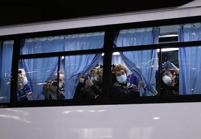 Americans aboard a bus as they leave the Diamond Princess cruise ship docked at Daikoku Pier Cruise Terminal for repatriation in Yokohama, south of Tokyo, Japan, on Feb. 17. Photo by Franck Robichon/EPA-EFE/