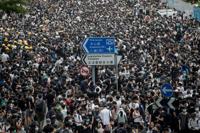 Protesters flood streets in Hong Kong despite controversial bill's suspension
