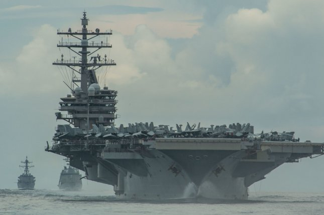 The U.S. and British militaries extended an agreement for enhanced carrier operations, which includes this week's exercise involving the U.S. Navy carrier USS Ronald Reagan, pictured, and Britain's HMS Queen Elizabeth carrier. Photo by Mass Communication Specialist 3rd Class James Hong/U.S. Navy