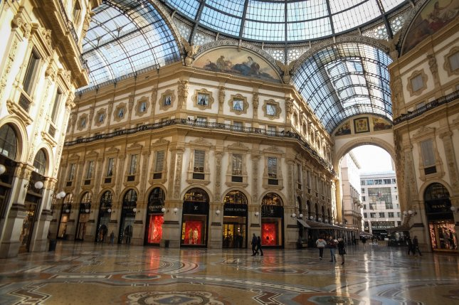 The Galleria Vittorio Emanuele II arcades shopping center stands empty in the Lombardian capital of Milan, northern Italy, back in March. Italy will begin to reopen shops in the region Monday. File Photo by Matteo Corner/ EPA-EFE