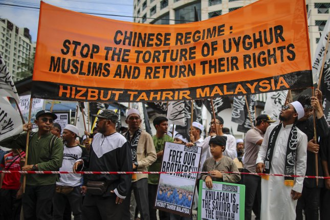 China's systemic repression of Muslims has led to pushback in the community, including rare public protests. EPA-EFE/FAZRY ISMAIL