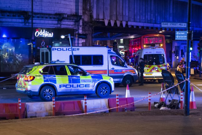 Police units respond to London Bridge after reports of a van hitting pedestrian on the bridge in central London on Saturday. Photo by Will Oliver/EPA