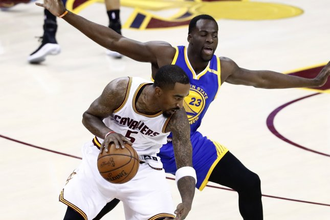 2049961dac89 Cleveland Cavaliers guard J.R. Smith (L) and Golden State Warriors forward  Draymond Green (R) in action in the first half of Game 3 of the NBA Finals  ...