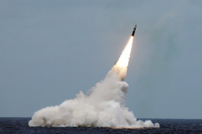 An unarmed Trident II D5 missile launches from the USS Maryland submarine off the coast of Florida. The Congressional Budget Office said maintaining and upgrading the U.S. nuclear arsenal over the next decade will cost $494 billion. File Photo by John Kowalski/U.S. Navy