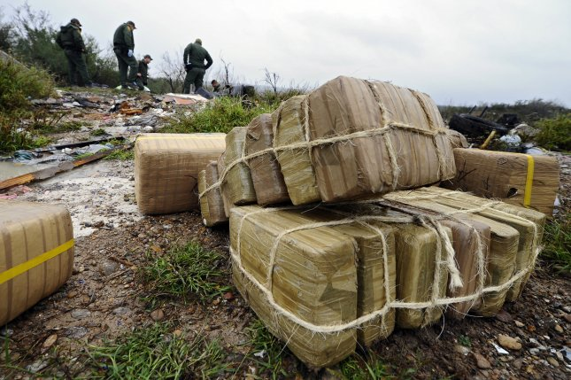 U.S. authorities seize nearly 500 pounds of marijuana that were found hidden in a trash dump in Garceno, Texas. This week, federal prosecutors are trying an accused member of a Texas-based trafficking group that smuggled marijuana and cocaine. File Photo by Larry W. Smith/EPA-EFE