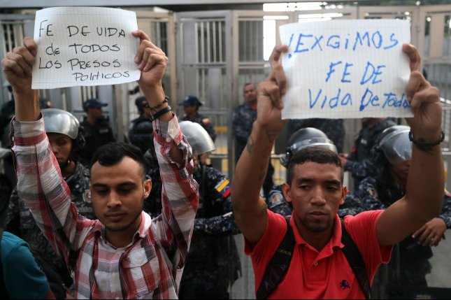 Supporters of imprisoned Venezuelan opponents hold signs that read Proof of life of all political prisoners and We demand proof of life from all during a protest in Caracas, Venezuela, on October 8. File Photo by Miguel Gutiérrez/EPA-EFE
