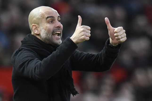 Manchester City and manager Pep Guardiola are free to compete in the 2020-2021 UEFA Champions League after the team's two-year ban from the tournament was overturned. Photo by Peter Powell/EPA-EFE