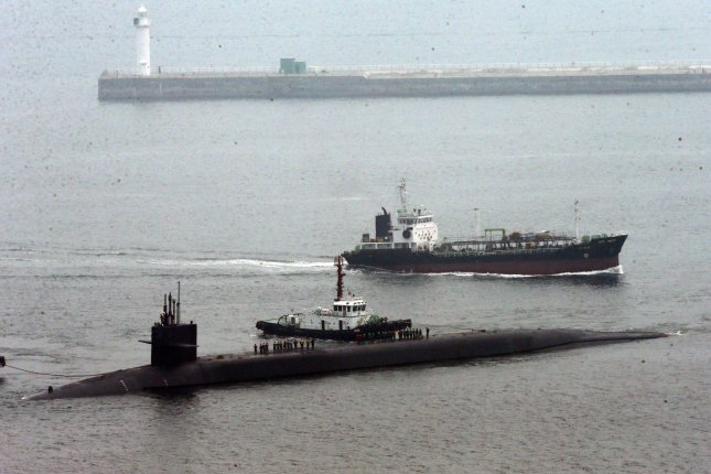 The nuclear-powered guided missile submarine USS Michigan is pictured in this June 2015 file photo at a Navy pier in the South Korean port city of Busan. The 18,000-ton submarine has a length of 170.6 meters and carries 150 Tomahawk cruise missiles. Photo by Yonhap News Agency/UPI