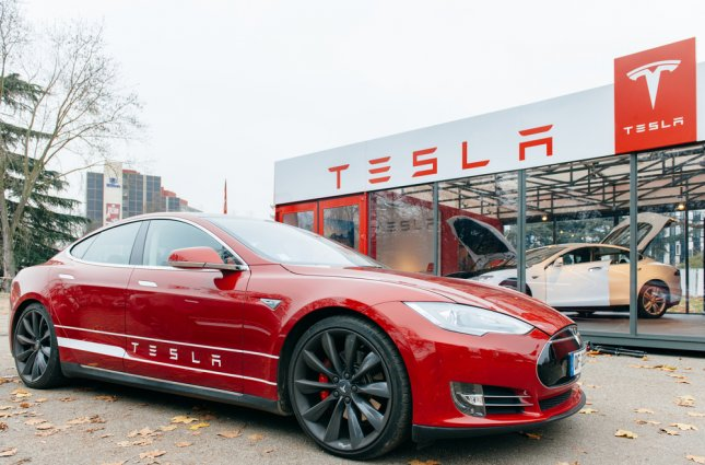 A Russian Tesla owner bought his car from the United States, but hasn't been able to charge it anywhere other than home or work. File Photo by Hadrian / Shutterstock