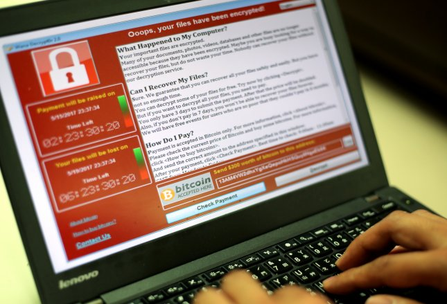 A programmer shows a sample of a ransomware cyberattack on a laptop in Taipei, Taiwan on May 13. This month, a security researcher found a 'keylogger' flaw in hundreds of HP laptops. File Photo by Ritchie B. Tongo/EPA