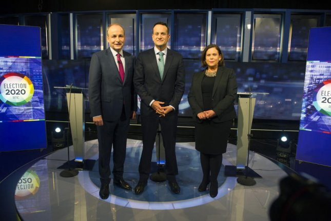 Irish prime minister and leader of the Fine Gael party Leo Varadkar (C) poses with the leaders of Fianna Fail party, Micheal Martin (L) and Sinn Fein president Mary Lou McDonald before the start of a televised debate this week. Photo by Aidan CrawleyEPA-EFE