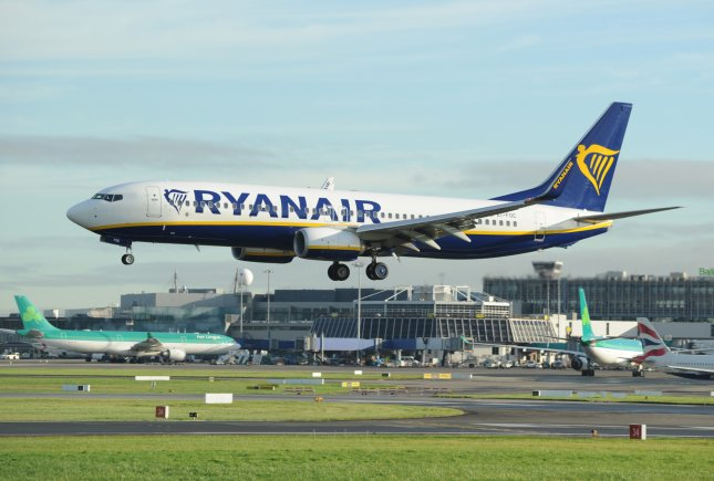 Ryanair and Oman Air announced Tuesday that they will ground most of their flights in response to government orders and other measures to prevent the spread of the global COVID-19 outbreak. File Photo by Aidan Crawley/EPA